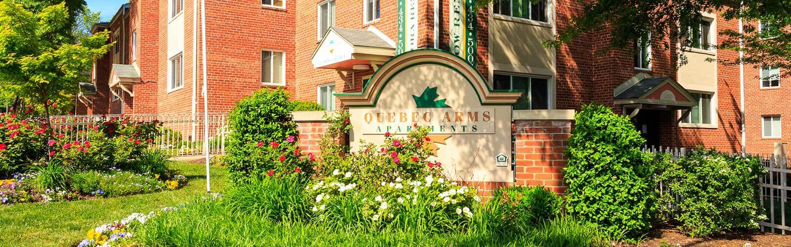Quebec Arms apartments Welcome Sign